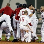 The Boston Red Sox including Jonny Gomes, right, Jacoby Ellsbury, second from right, and Dustin Pedroia (15) celebrate after a walkoff-single by Daniel Nava that scored Pedroia in the ninth inning of a baseball game against the Seattle Mariners in Boston, Thursday, Aug. 1, 2013. The Red Sox won 8-7. (AP Photo/Michael Dwyer)
