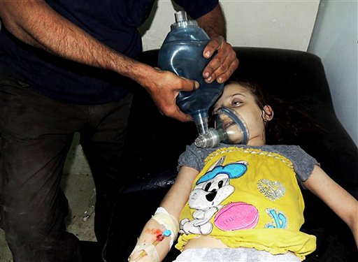This citizen journalism image provided by the Local Committee of Arbeen shows a Syrian girl receiving treatment at a makeshift hospital, in Arbeen, Damascus, Syria, on Wednesday. The image has been authenticated based on its contents and other AP reporting.