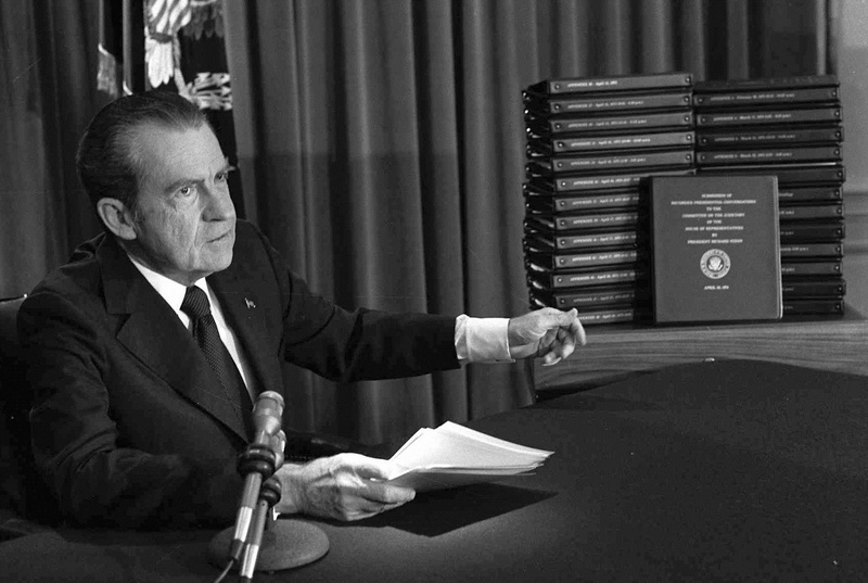 President Richard M. Nixon points to the transcripts of the White House tapes after he announced during a nationally-televised speech that he would turn over the transcripts to House impeachment investigators, on April 29, 1974, in Washington.