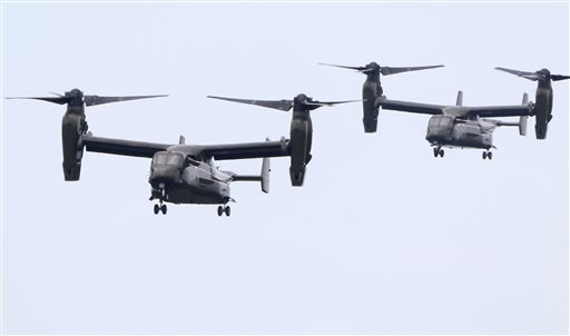 """Two MV-22 """"Osprey"""" aircraft approach an airfield in Edgartown, Mass. on the island of Martha's Vineyard while flying in support of the Marine One helicopter carrying President Obama on Saturday."""