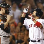 Boston's Shane Victorino, right, gestures as he crosses home plate after hitting a two-run homer while Baltimore Orioles catcher Matt Wieters watches at Fenway Park Tuesday.