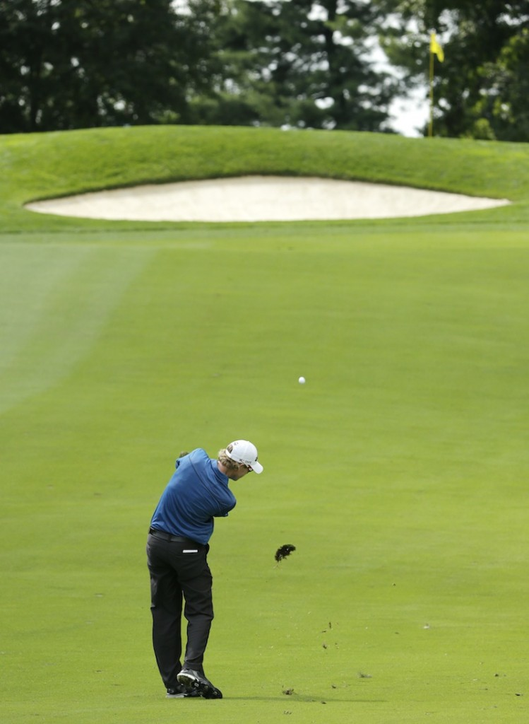 David Hearn, of Canada, hits from the fairway on the 14th hole during the first round of the PGA Championship golf tournament at Oak Hill Country Club, Thursday, Aug. 8, 2013, in Pittsford, N.Y. (AP Photo/Charlie Riedel)