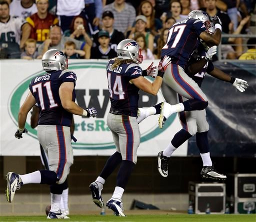 From right to left, New England Patriots' LeGarrette Blount, Aaron Dobson, Zach Sudfeld and R.J. Mattes celebrate after Blount's touchdown during the first half of a preseason NFL football game against the Philadelphia Eagles, Friday, Aug. 9 in Philadelphia. (AP Photo/Matt Rourke)