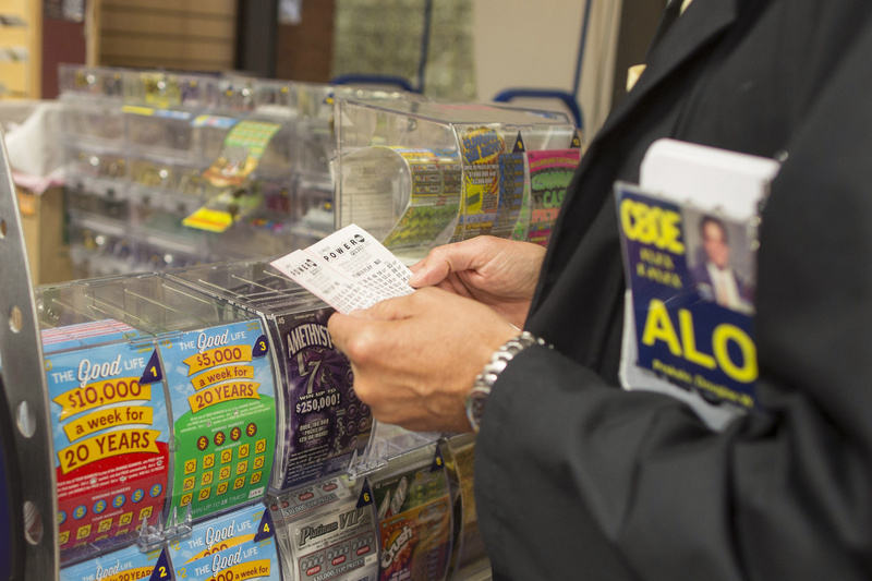 Douglas Priskalo purchases Powerball tickets at a convenience store in Chicago Wednesday.
