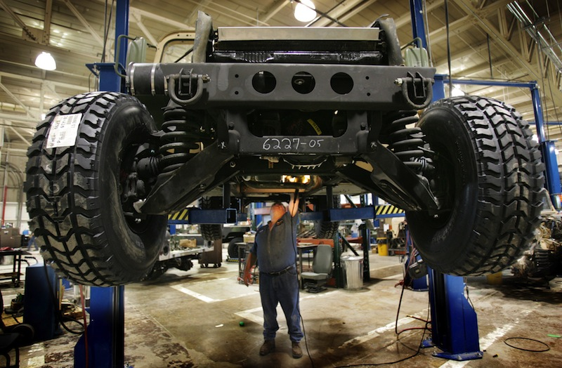 A mechanic inspects the underside of a refurbished Humvee at the Maine Military Authority in Limestone in 2005. Over the years, Maine Military Authority refurbished more than 16,000 vehicles, generated $600 million in revenue and, at its peak, employed roughly 550 workers.
