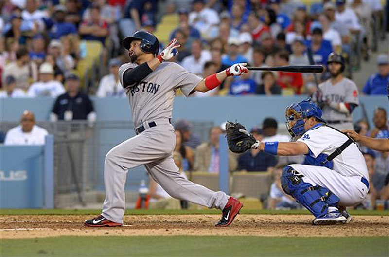 Boston's Shane Victorino hits a solo home run in the seventh inning Sunday in Los Angeles. The Red Sox beat the Dodgers, 8-1.