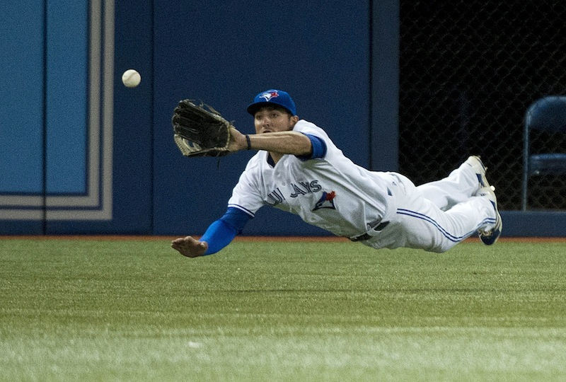 Toronto Blue Jays left fielder Kevin Pillar makes diving catch of a ball hit by Boston Red Sox' Jonny Gomes during the sixth inning of a baseball game in Toronto on Wednesday, Aug. 14, 2013. (AP Photo/The Canadian Press, Nathan Denette) Blue Jays;athlete;athletes;athletic;athletics;Canada;Canadian;Center;Centre;competative;compete;competing;competition;competitions;event;game;Jays;League;Major;MLB;pro;professional;Rogers;sport;sporting;sports;Toronto;baseball;American;AL;2013