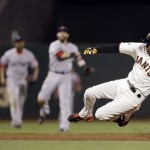 San Francisco Giants' Joaquin Arias slides into third base with an RBI triple against the Boston Red Sox during the fifth inning of Tuesday's game. The Giants won, 3-2.
