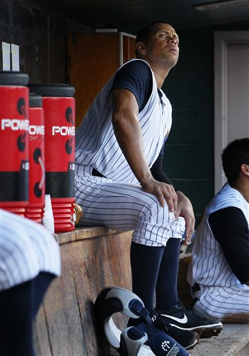 New York Yankees' Alex Rodriguez looks out from the dugout during a Class AA baseball game with the Trenton Thunder against the Reading Phillies on Friday in Trenton, N.J.