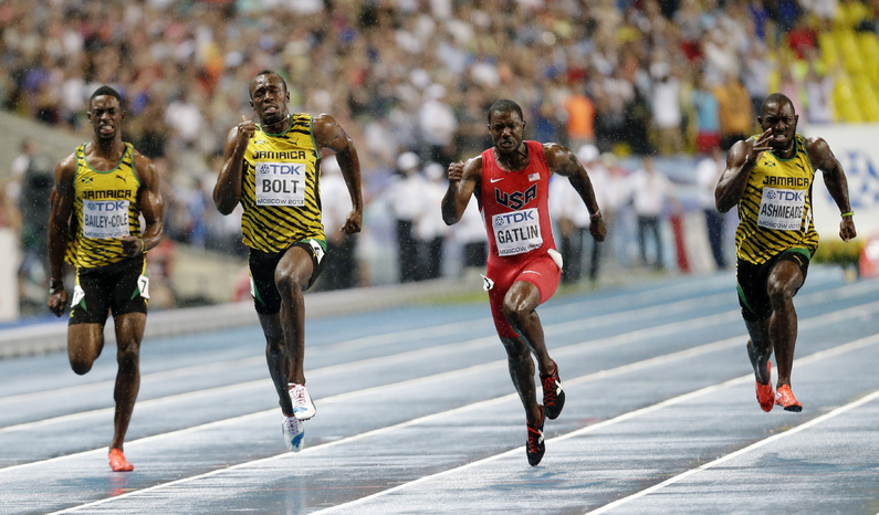 Jamaica's Usain Bolt, second from left, races to victory against Jamaica's Kemar Bailey-Cole, left, USA's Justin Gatlin and Jamaica's Nickel Ashmeade in the Men's 100-meter final at the World Athletics Championships in Moscow, Russia on Sunday.