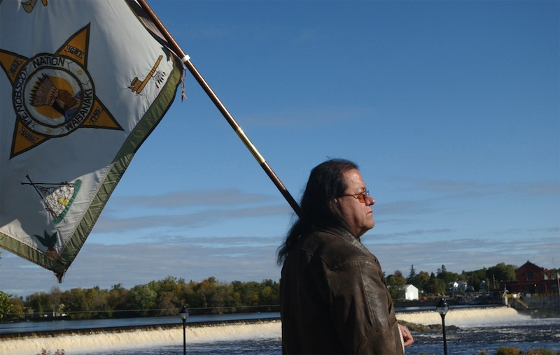 In this 2006 file photo, then-Penobscot Tribal Council member James Neptune watches an eagle fly over the Penobscot River in Orono, Maine. The federal government, saying
