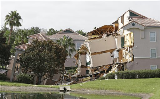 Damage to buildings caused by a sinkhole 40 to 50 in diameter is seen at the Summer Bay Resort on Monday in Clermont, Fla.