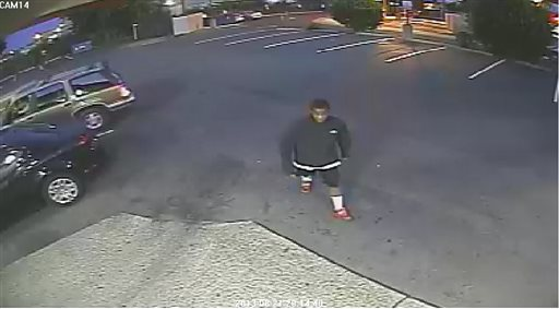 This image from surveillance video provided by the the Spokane, Wash., Police Department shows a person authorities say is a suspect in the beating death of an 88-year-old Delbert Belton outside an Eagles lodge in Spokane.