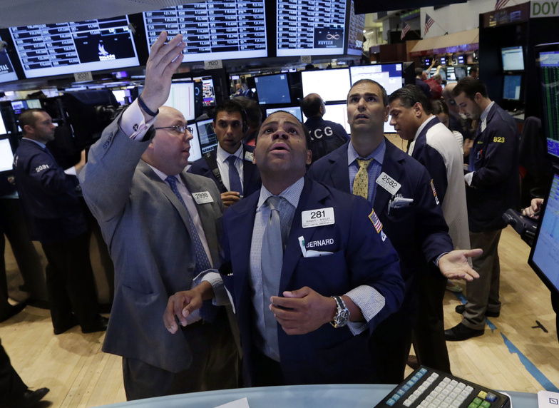 Specialists Peter Kennedy, Bernard Wheeler and Philip Finale confer on the floor of the New York Stock Exchange on Wednesday. Global markets rose Thursday.