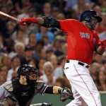 Red Sox designated hitter David Ortiz hits a two-run single as White Sox catcher Josh Phegley watches during the fourth inning at Fenway Park on Friday.