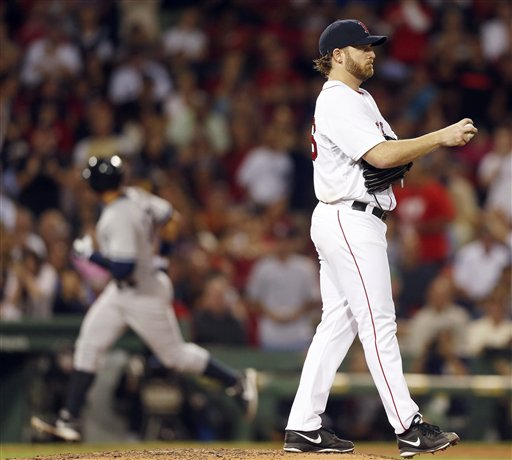 Boston Red Sox's Ryan Dempster looks to the outfield as New York Yankees' Alex Rodriguez rounds third base on a solo home run in the sixth inning of a baseball game in Boston on Sunday.