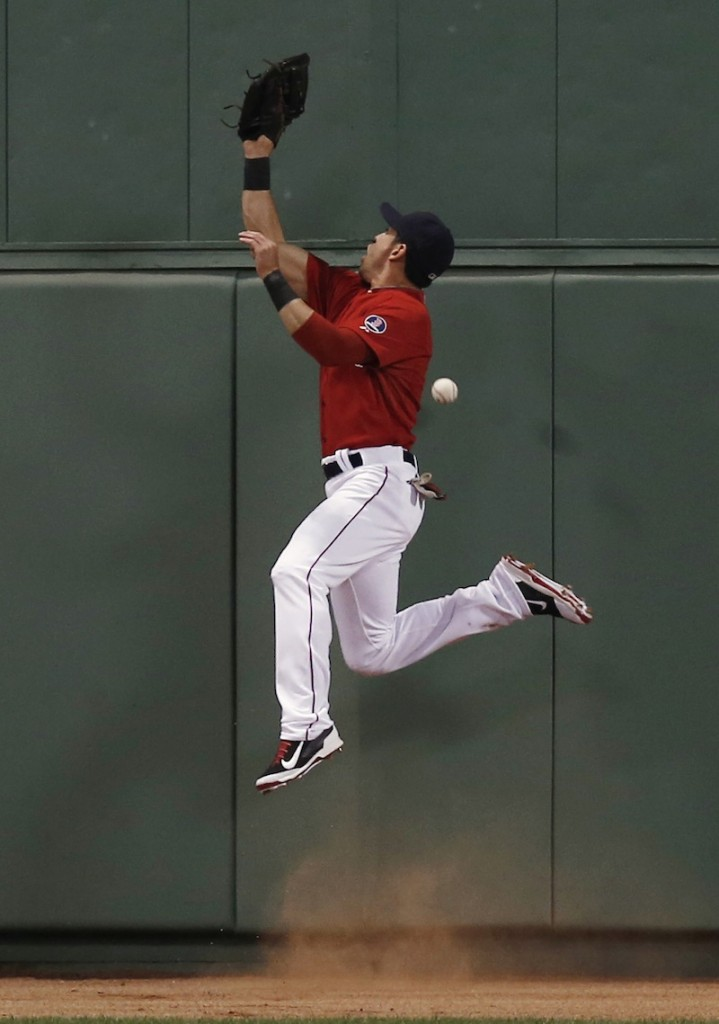 Boston center fielder Jacoby Ellsbury leaps high but can't make the catch on what turned out to be a triple by Eduardo Nunez in the fourth inning of the Yankees' 10-3 win.