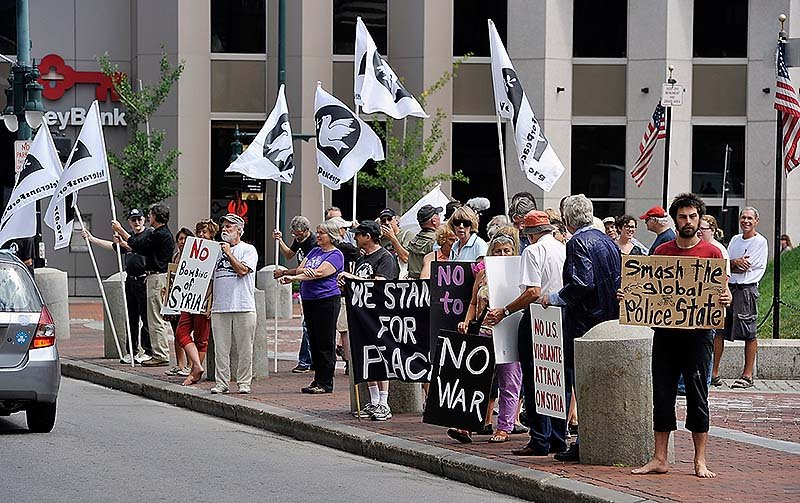 The Veterans for Peace, Code Pink and Peace Action Maine held a rally Saturday against US intervention in Syria. Michael Anthony of Portland, right, joined the rally with other objectives.
