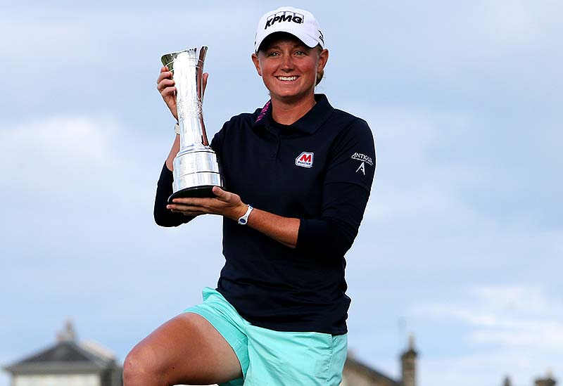 Stacy Lewis of the US poses with the trophy after winning the Women's British Open golf championship on the Old Course at St. Andrews, Scotland, on Sunday.