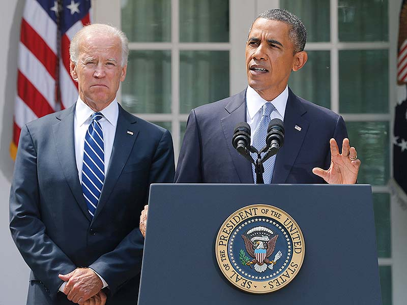 President Barack Obama stands with Vice President Joe Biden as he makes a statement about Syria in the Rose Garden at the White House in Washington on Saturday. Obama said he has decided that the United States should take military action against Syria in response to a deadly chemical weapons attack, and he will seek congressional authorization for the use of force.