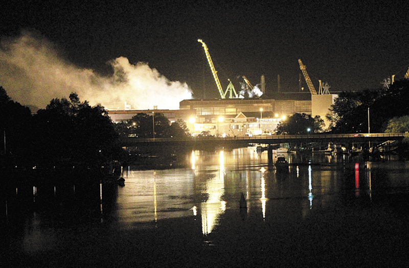 Smoke rises from a Portsmouth Naval Shipyard dry dock as fire crews respond May 23, 2012 to a fire on the USS Miami nuclear submarine at the Portsmouth Naval Shipyard on an island in Kittery in 2012.