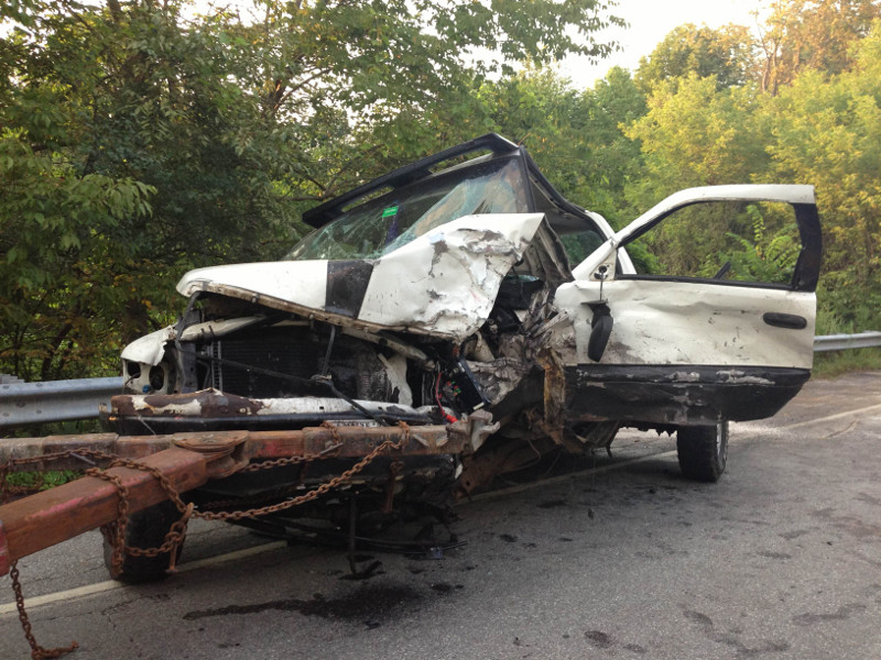 One of two pickup trucks involved in a double-fatal, head-on collision on Riverside Drive in Vassalboro on Monday afternoon is attached to a wrecker.