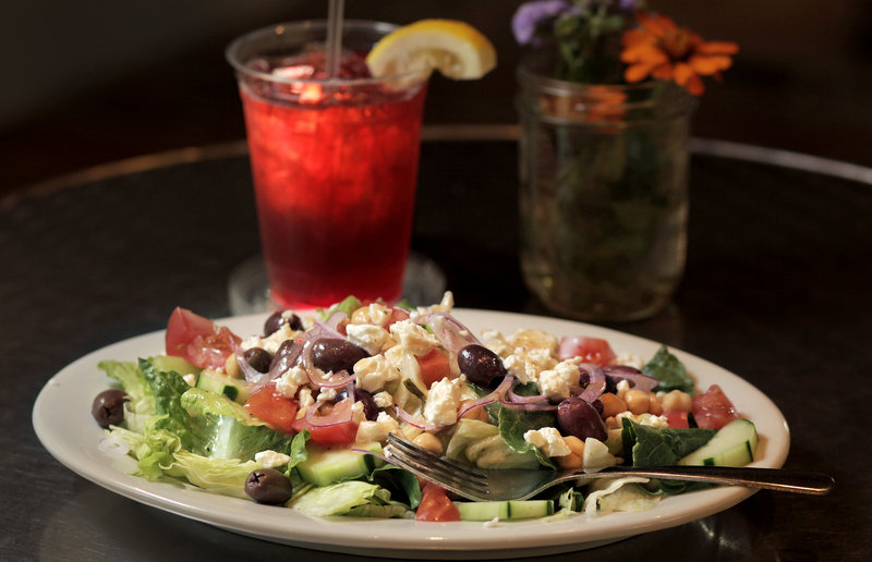 A Greek salad and passion fruit iced tea at Doc's Cafe in Cumberland.