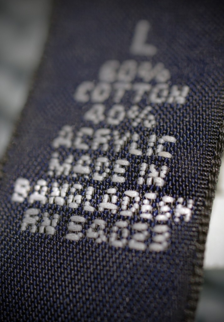 A label inside a cardigan sweater sold by a U.S. retailer informs consumers that the garment was made in Bangladesh.