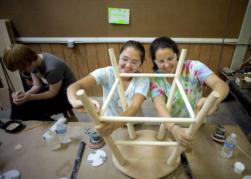Emily Decker and Ali Sugarman of St. Timothy's all-girls private school in Maryland work on assembling a stool at the Thos. Moser Cabinetmakers Workshop in Auburn, Maine on Thursday, August 1, 2013. A group of girls from the school spent the week in Auburn, building furniture that will go in their new student center.