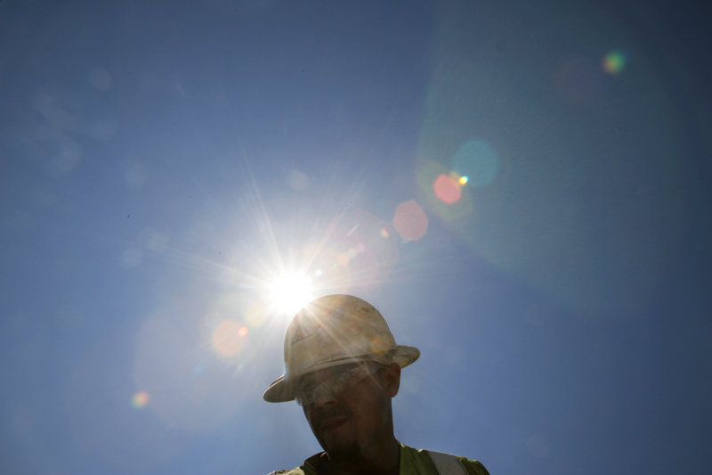 A construction worker endures the heat in San Jose, Calif., as temperatures surge during a heat wave. A massive new study finds that aggressive acts become more likely with each added degree.