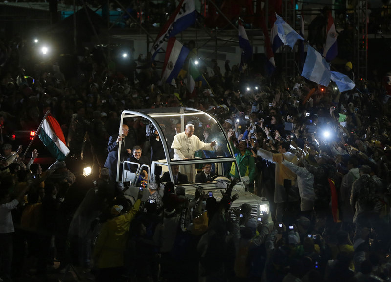 Pope Francis waves from his popemobile as he makes his way through the crowds lining the Copacabana beachfront in Rio de Janeiro, Brazil, last month, during his first international trip since being elected pope.