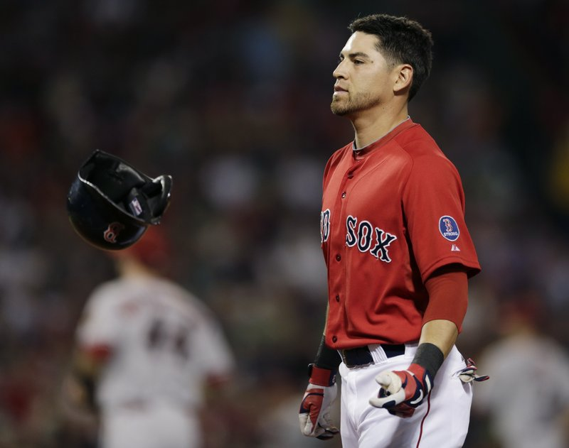 Jacoby Ellsbury of the Boston Red Sox flips his helmet Friday night after flying out with the bases loaded to end the fourth inning – part of a 7-6 loss to the Diamondbacks.