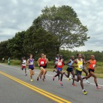 The lead pack of runners pulls away from the rest of the field early in Saturday's race.