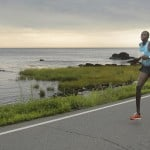 Eventual winner Micah Kogo of Kenya tucks in behind Silas Kipruto near Pond Cove between Miles 4 and 5 of the Beach to Beacon 10K. Kogo went on to beat Kipruto by five seconds.