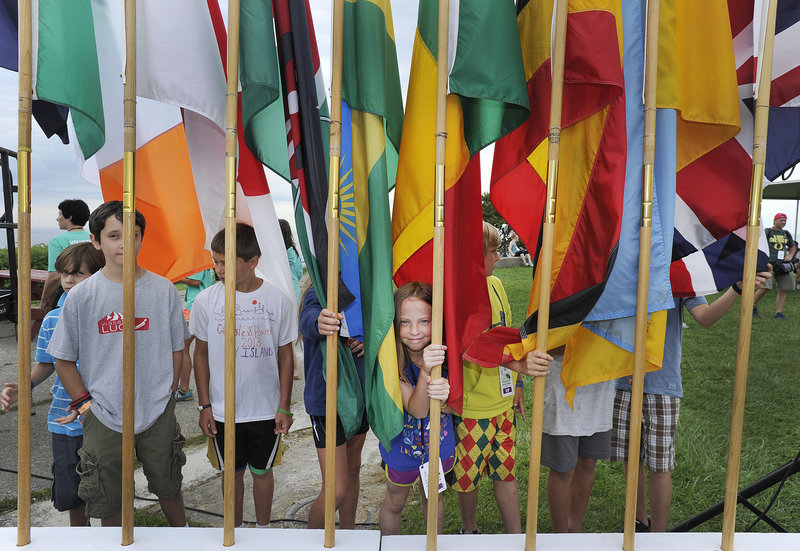 Young flag bearers await the flag parade representing the home countries of participants in the race.