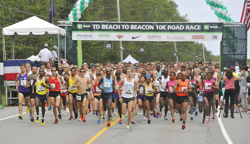 Runners jockey for position at the start of the race on Route 77.