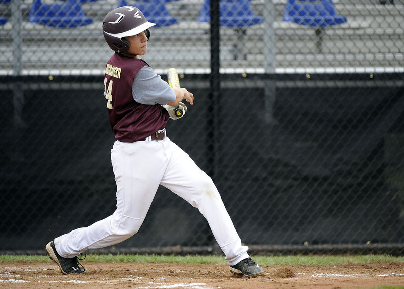 Brogan Searle-Belanger of Saco follows through on his three-run homer. Saco will play Westport, Conn., on Sunday night in the third of its four group games.