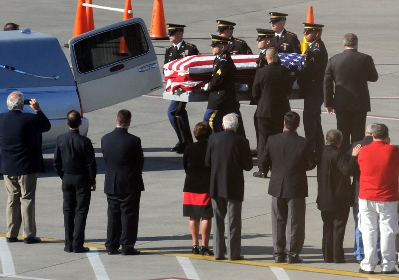The remains of Sgt. Dominick J. Licari of Frankfort, N.Y., a member of the Army Air Corps during World War II, arrive at the Albany International Airport on Friday afternoon.
