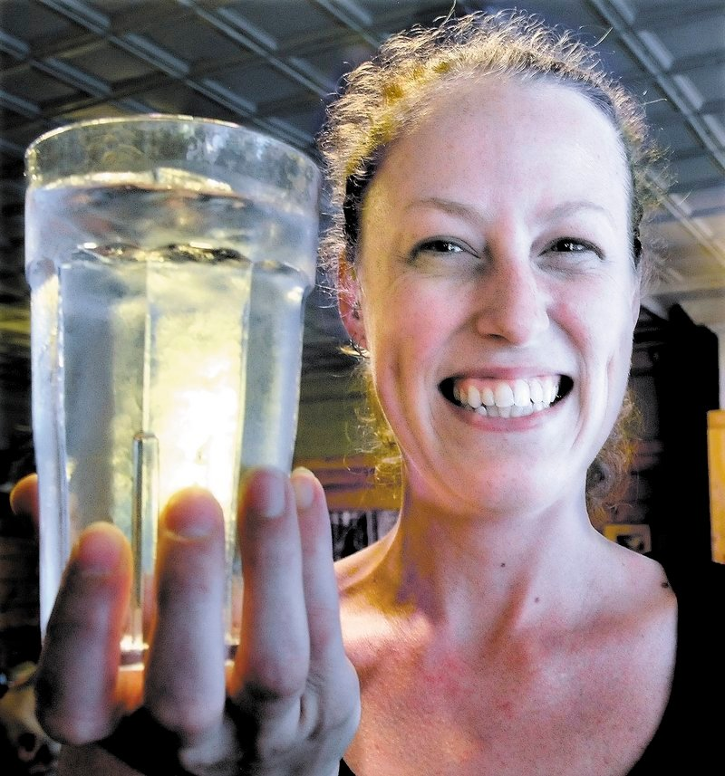 """Amber Strickland holds a glass full of water from the Bingham water supply at Thompson's restaurant recently. Strickland said she has lived all over New England and Bingham water is the best tap water she has had. """"We have never heard a complaint from customers,"""" Strickland said."""