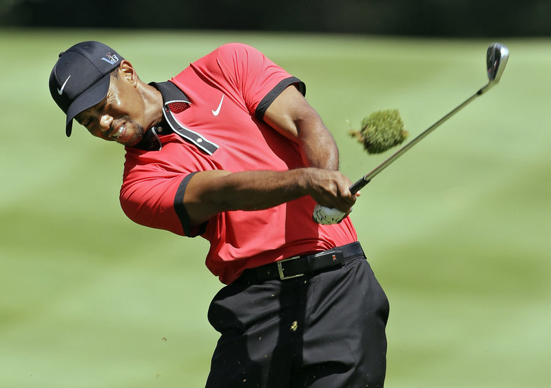 Tiger Woods hits an iron to the sixth green in the Bridgestone Invitational at Akron, Ohio on Sunday. Woods' win was his 79th on the PGA Tour, three away from Sam Snead's total of 82.