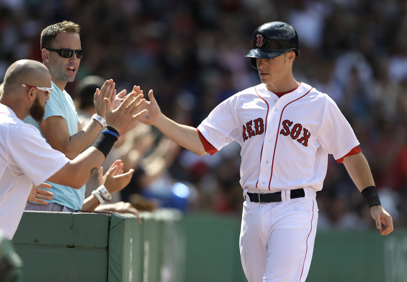 Boston's Brock Holt gets the glad-hand treatment after scoring on a double by Dustin Pedroia in a 4-0 win over the Arizona Diamondbacksat Fenway Park on Sunday. The win was Boston's seventh in the last nine games, including a 5-2 mark in the recent homestand.