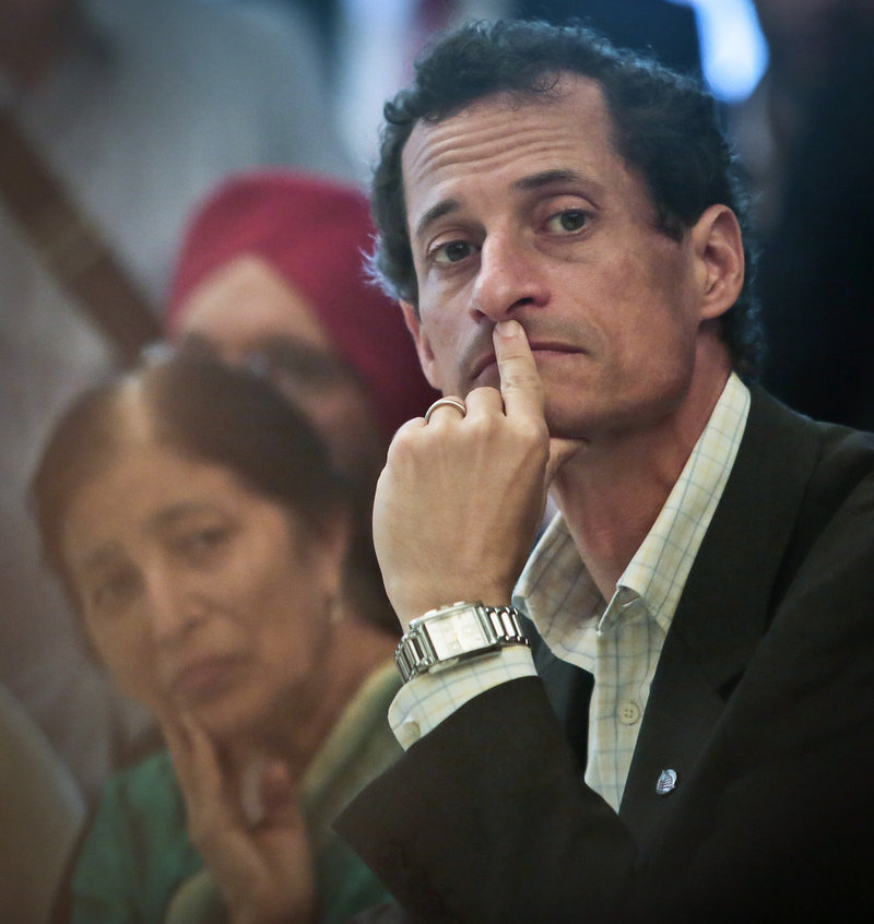 "New York mayoral candidate Anthony Weiner, listens during a meeting with leaders from the South and East Asian communities in Queens on Friday. By staying in the race, Weiner will ""have millions of dollars' worth of polished ads that could improve people's opinions of him. It's not harebrained,"" says political consultant Joseph Mercurio."