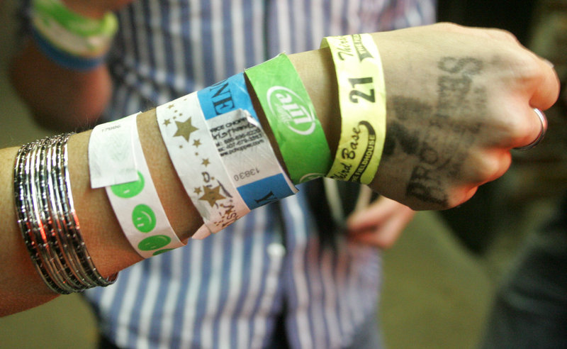 A patron shows wrist bands she collected visiting bars in downtown Iowa City. The Princeton Review named the University of Iowa the nations's best party school.
