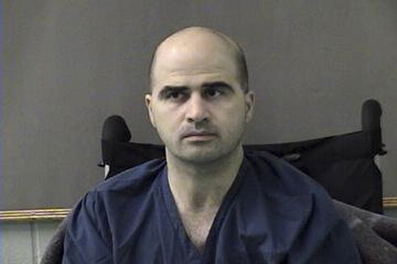 The defendant, Maj. Nidal Malik Hasan, was shot in the rampage and is paralyzed from the abdomen down.