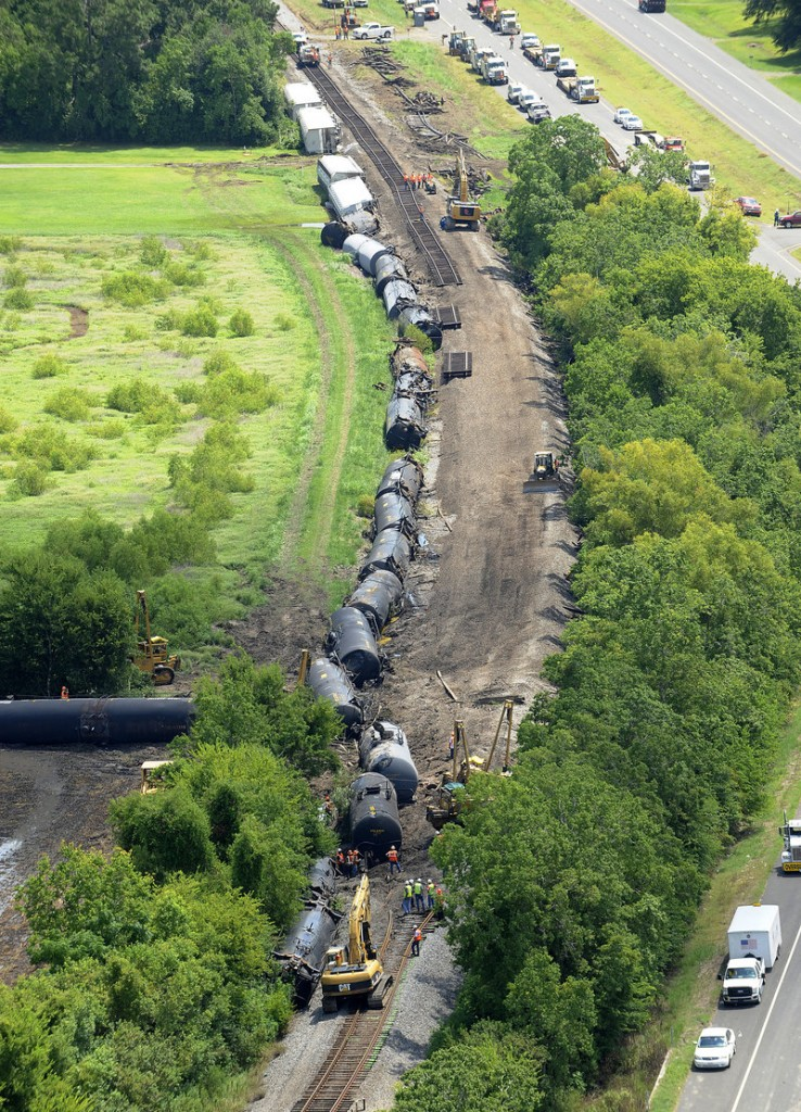 Railroad repair crews work on 1,800 feet of Union Pacific railroad track Monday after a train derailed Sunday just east of Lawtell, La.
