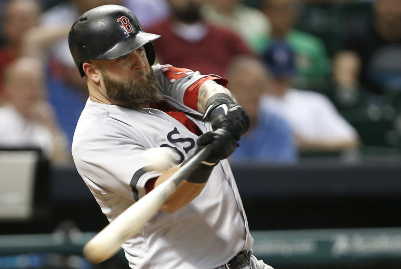 Boston's Mike Napoli fouls off a pitch against Houston reliever Josh Fields in the eighth inning of a 2-0 win by the Astros at Houston on Monday. Napoli eventually struck out.