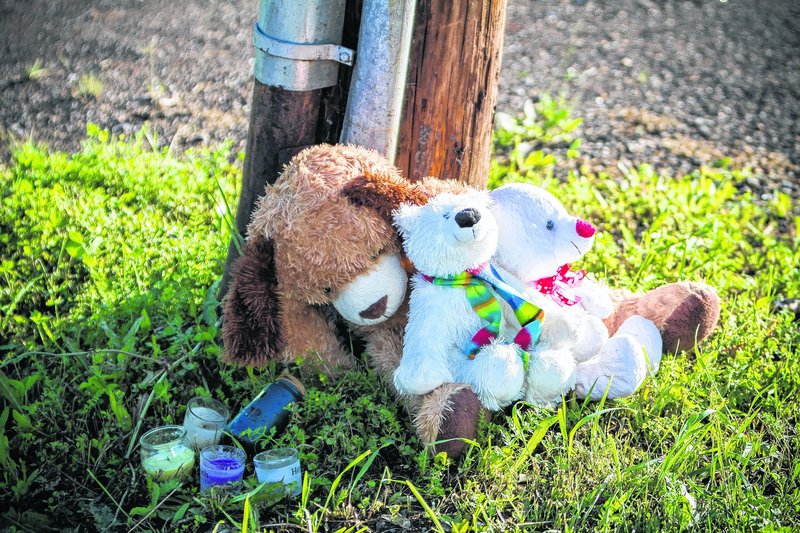 Stuffed animals and candles form a memorial outside the Reptile Ocean exotic pet store in Campbellton, New Brunswick. Two boys were killed by a python in an apartment above the store.