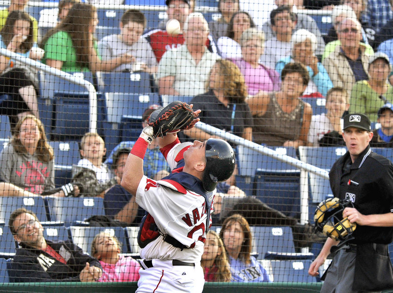 Portland catcher Christian Vazquez keeps his eyes on the ball Tuesday night while hauling in a foul pop fly at Hadlock Field during an 8-2 loss to the Richmond Flying Squirrels that dropped the Sea Dogs to three games under .500.