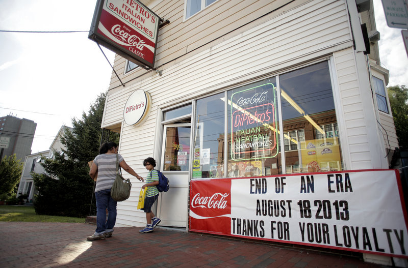 Patrons walk out of DiPietro's Italian Sandwiches on Cumberland Avenue during the dinner rush Thursday, August 8, 2013. The store will be closing its doors next Sunday, August 18, after 69 years in business.
