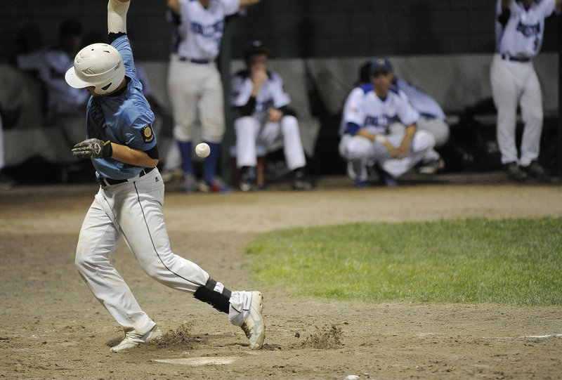 John Herzig of the Windham Merchants is hit by a pitch Thursday night in the third inning of a 13-4 loss to Middletown, Conn., in the American Legion regionals.